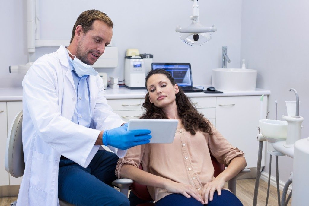 Dentist discussing to a patient