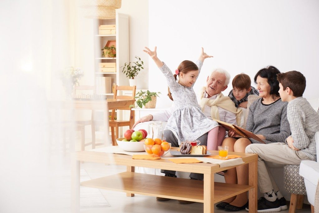 Elderly couple with their grandkids