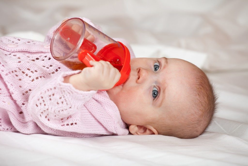 Baby drinking on her cup