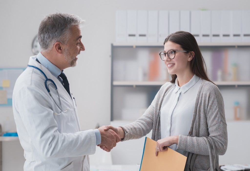 Patient shaking hands with the doctor