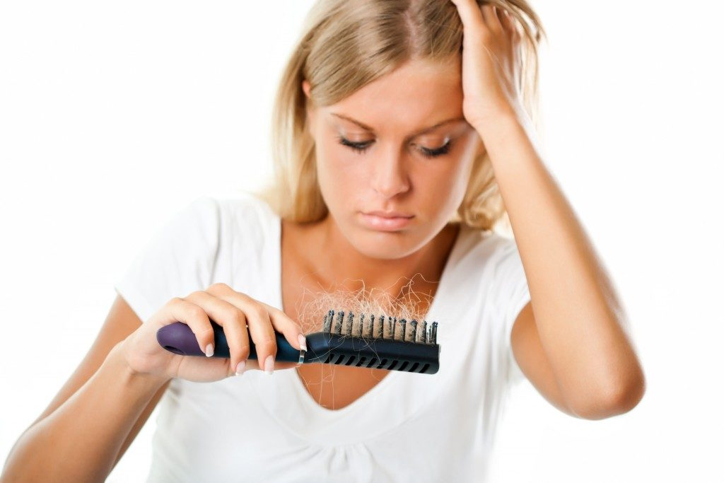 Woman worried of hair loss