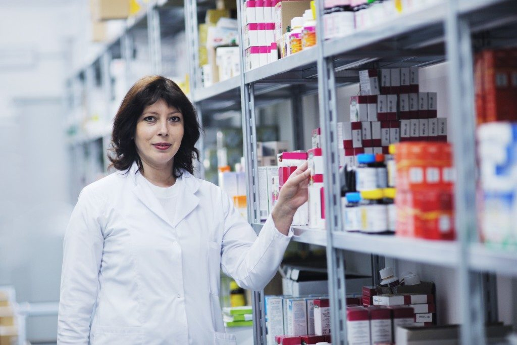 pharmacist with a stock of medication