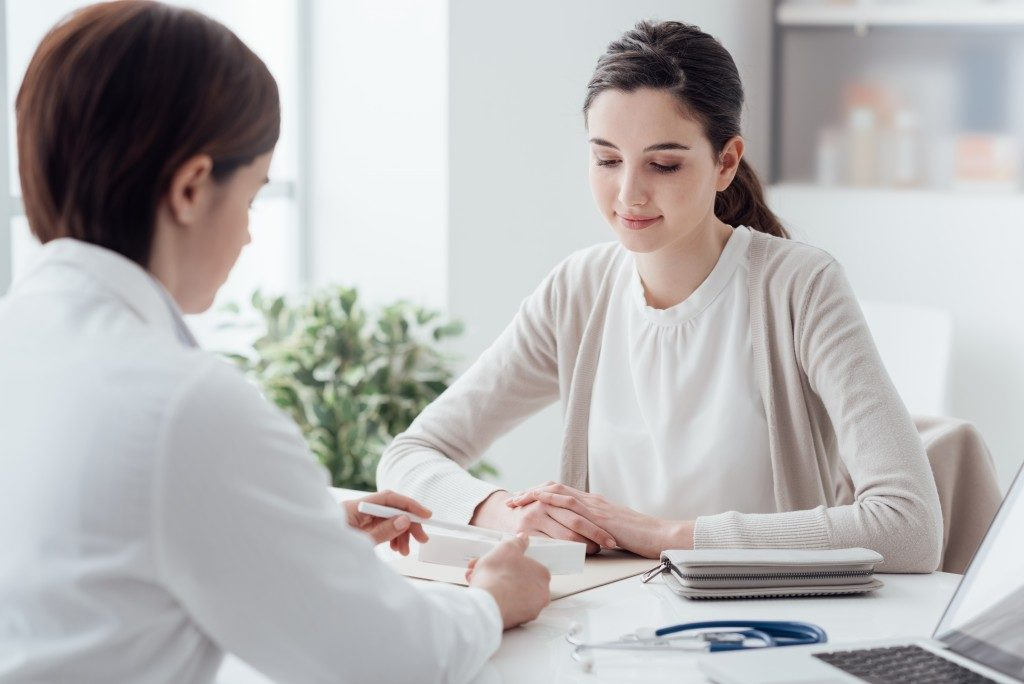 Woman consulting Doctor about haemorrhoids