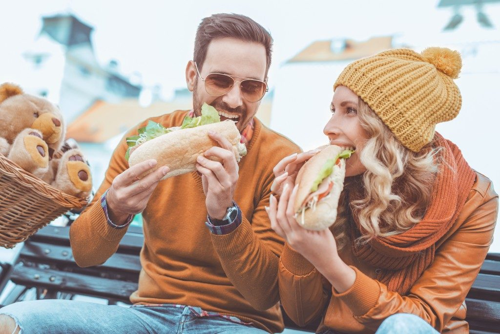 Couple eating sandwhich