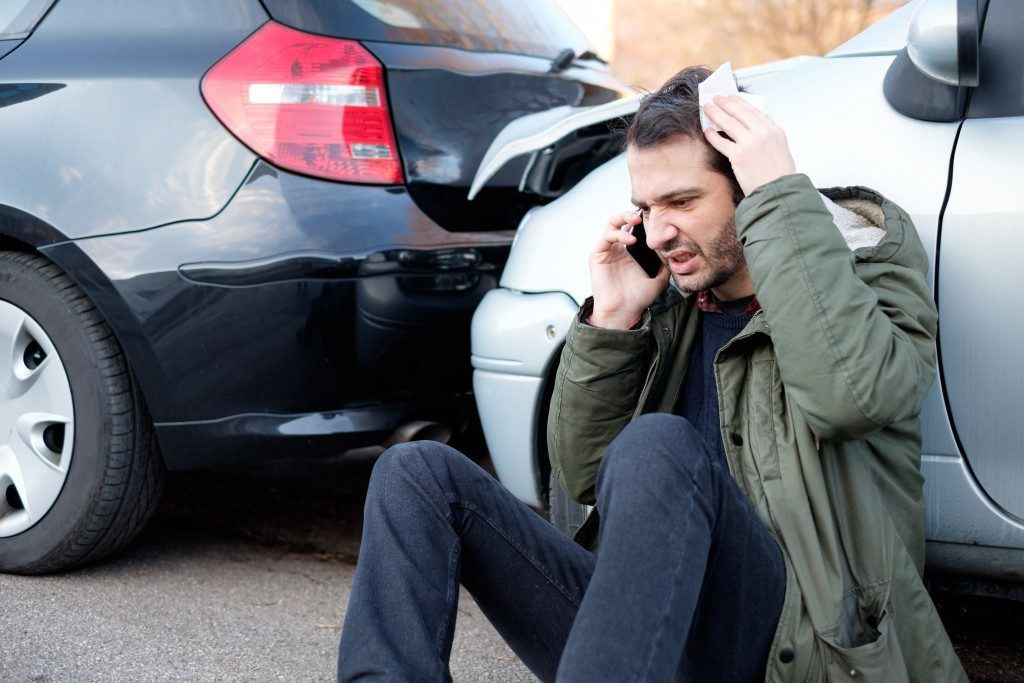 man calling about car crash