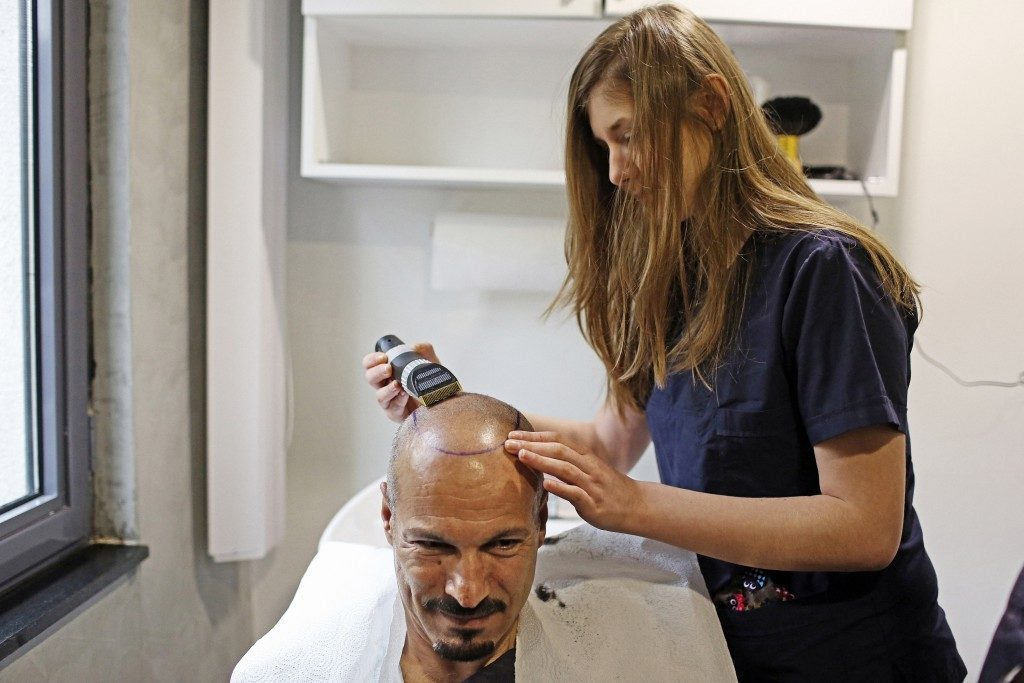 man having hair treatment