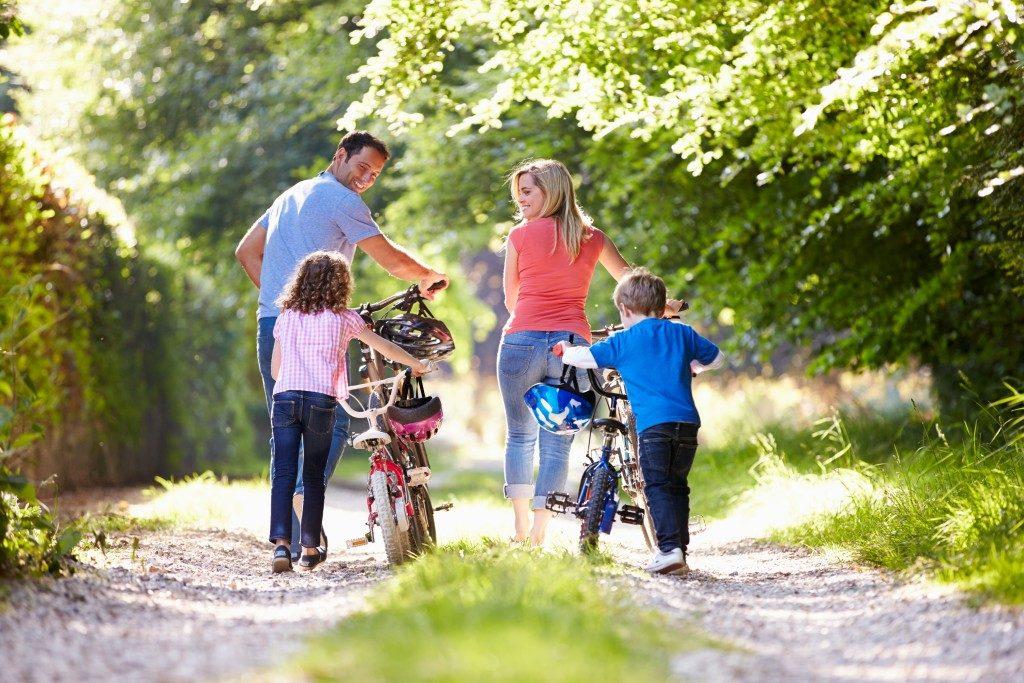 Family walking with their bikes