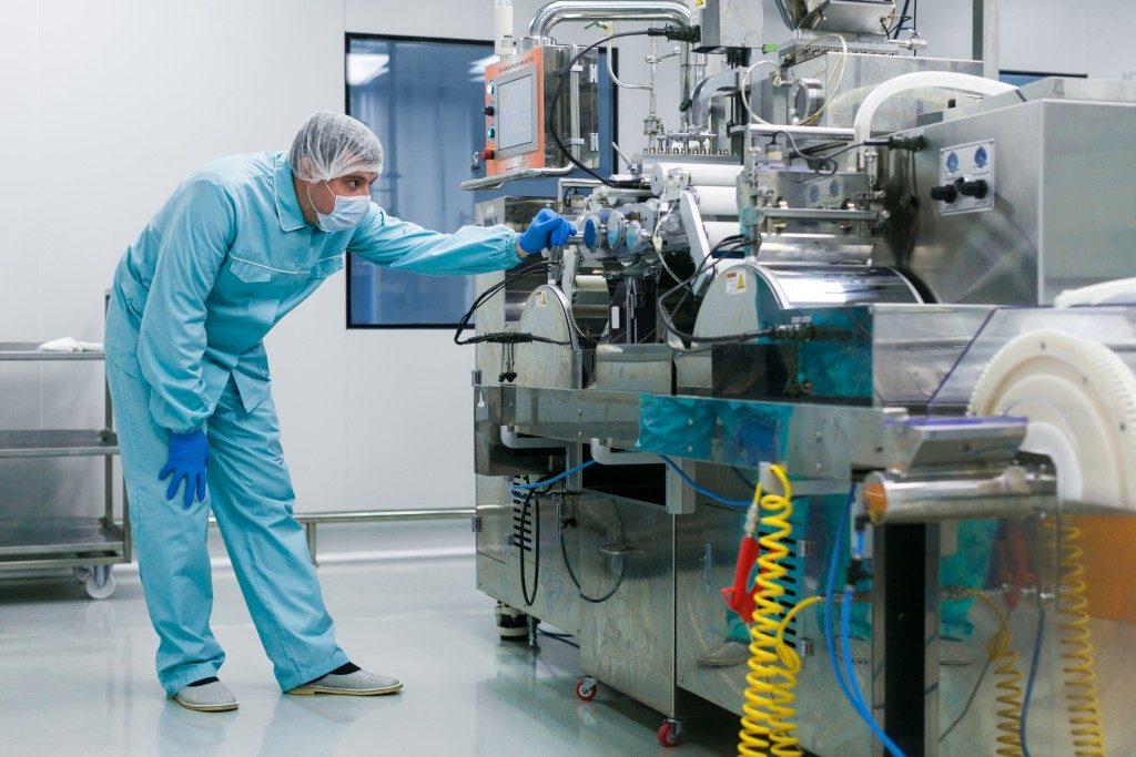 lab technician operating modern equipment