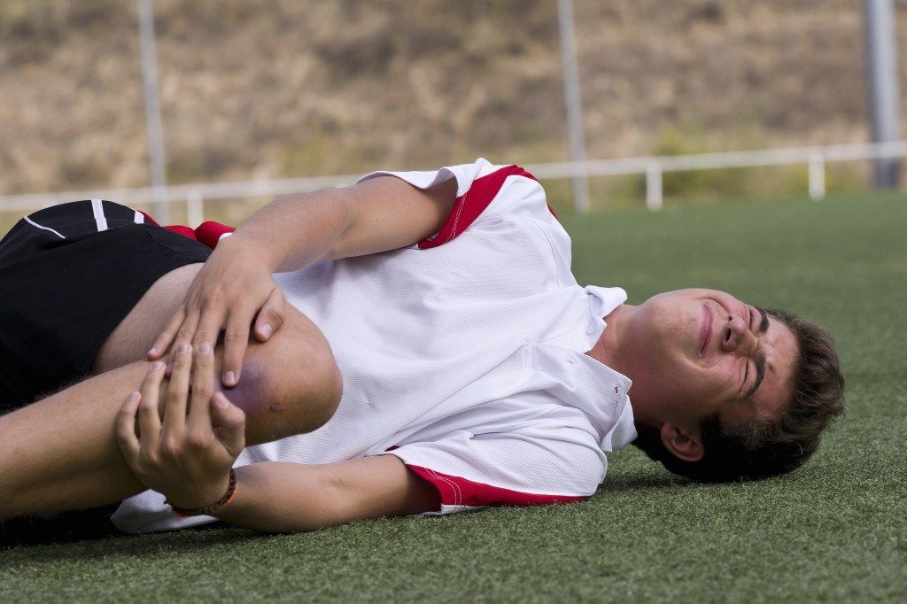 Footballer having a muscle pain