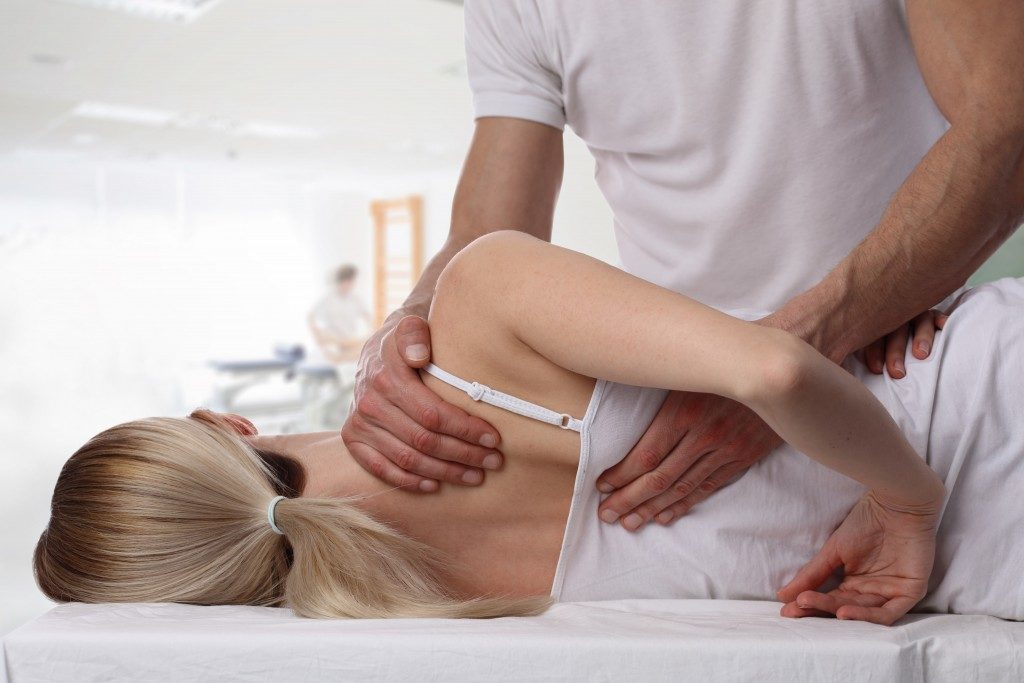 chiropractor about to crack a woman's back