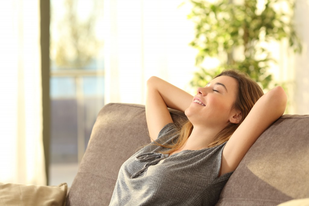 woman relaxing in the living room