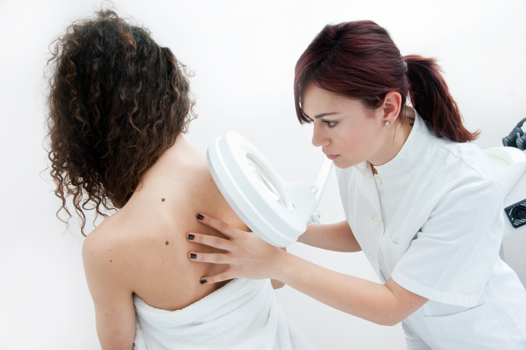 doctor checking the back of a woman