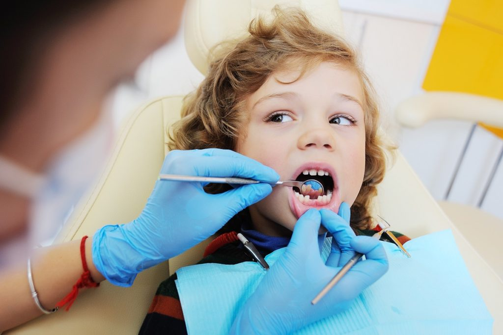 kid at the dentist