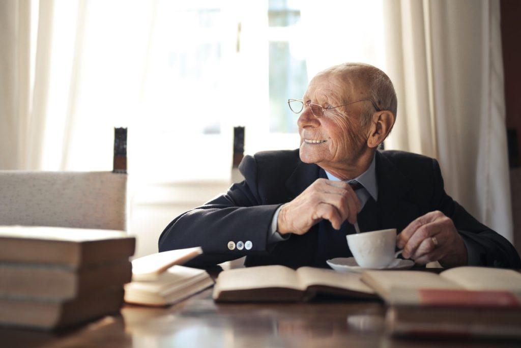 old man reading books